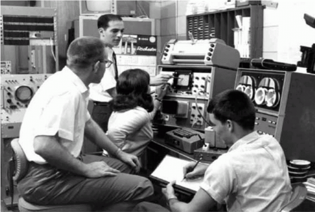 Figure 6. Upper photograph shows Weiss at Cambridge during the summer of 1963 where he assembled and tested his own computer and learned to program it as part of the LINC Evaluation Project. The lower photograph shows two students, a technician, and an engineer using the LINC in Weiss and Laties' laboratory at Rochester in 1966 (Photographs by Bernard Weiss, reprinted with permission).